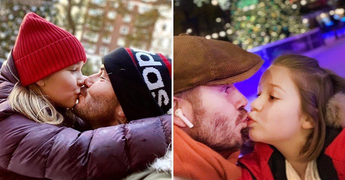 папа целует дочь